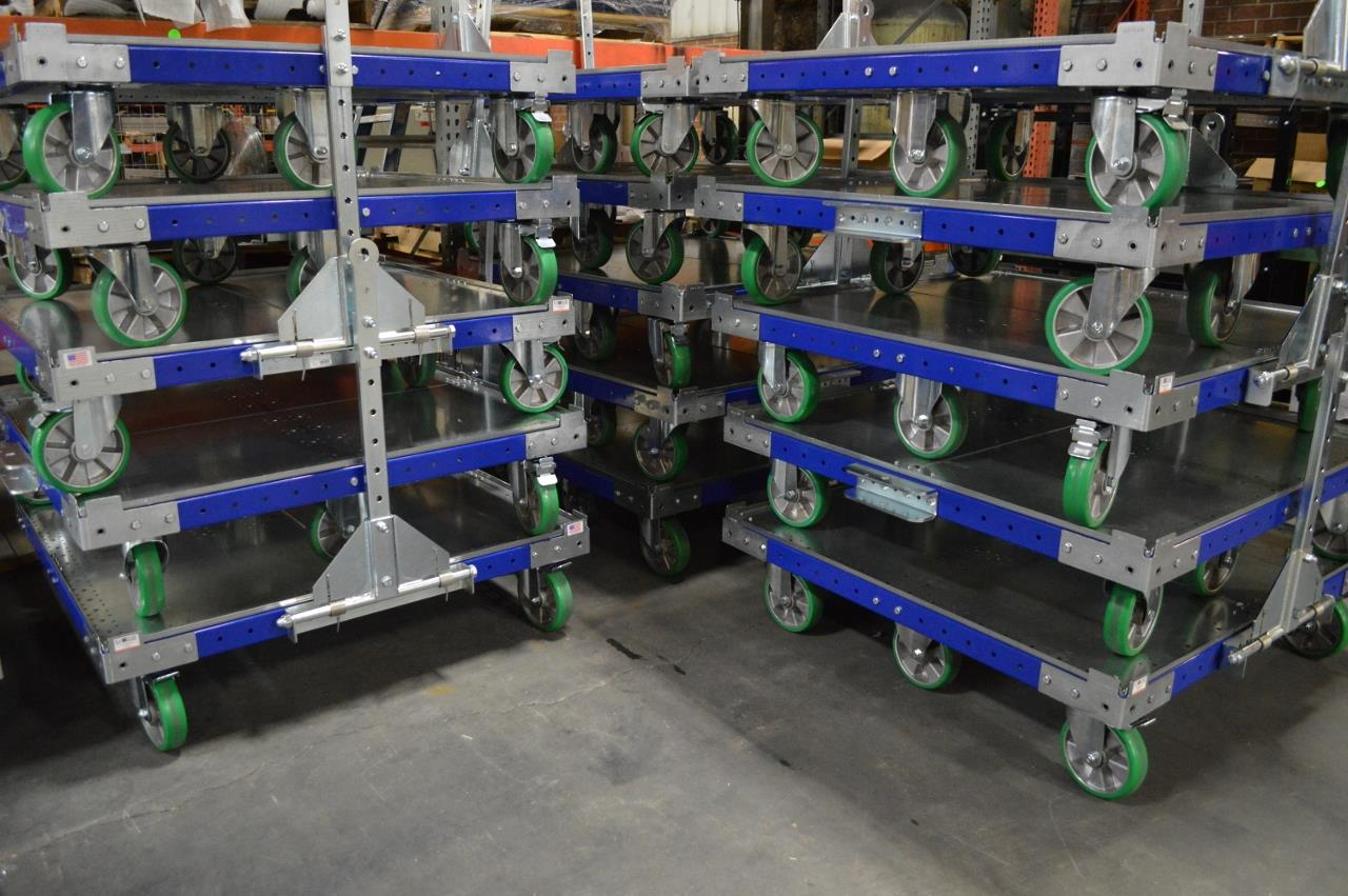 FlexQube carts stacked in a manufacturing facility