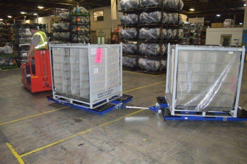 FlexQube tugger carts with Raymond tugger