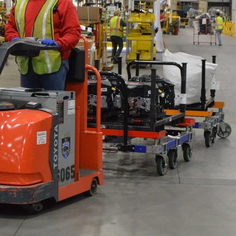 FlexQube tugger carts being towed by a tugger