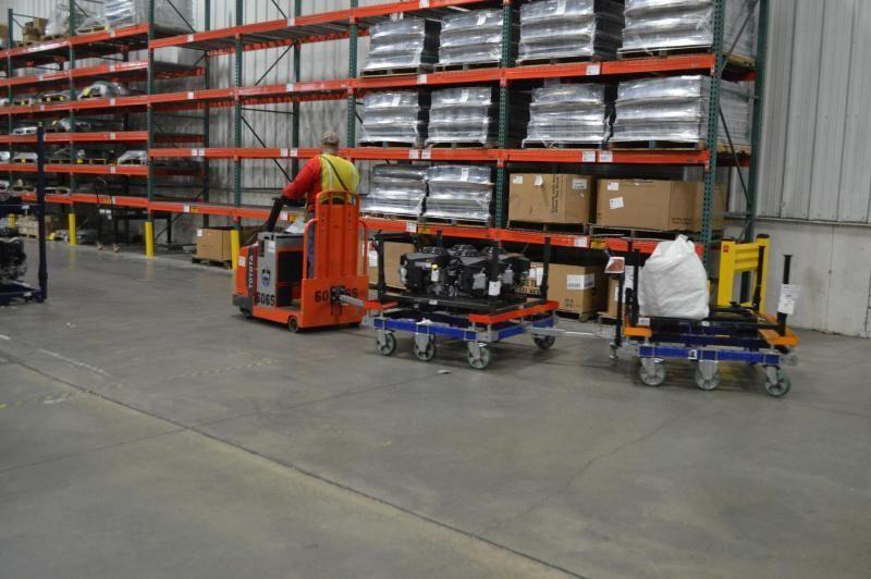 FlexQube tugger carts in use