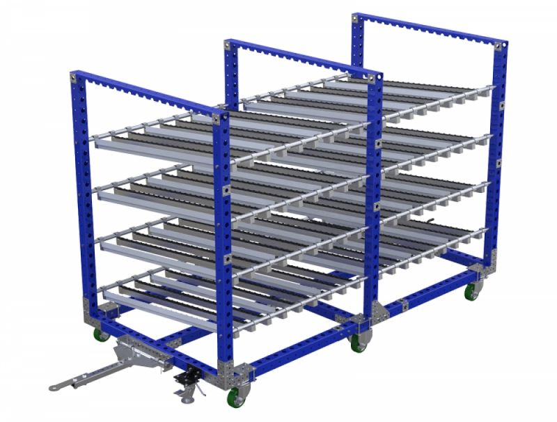 Material handling flow rack with tow bar