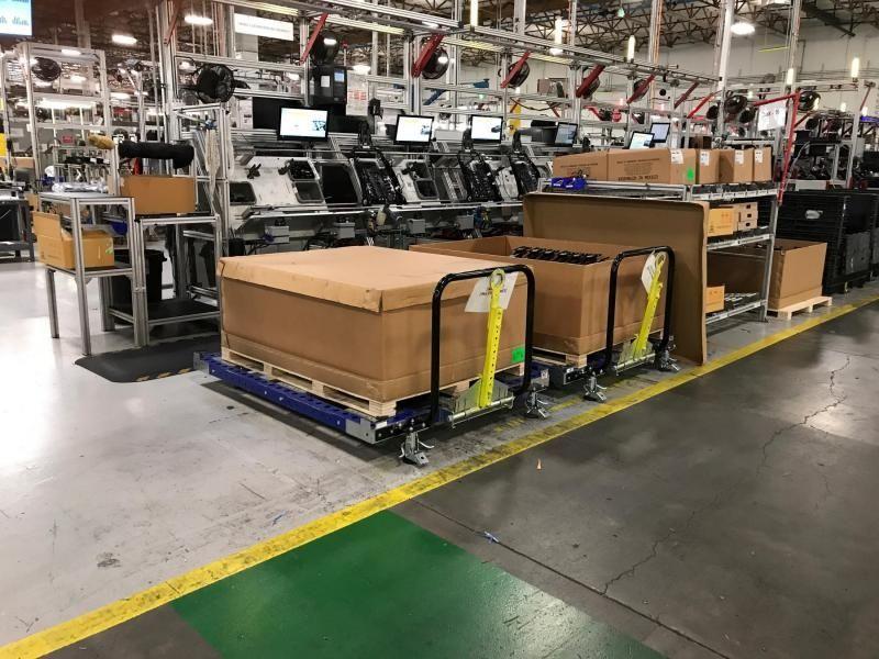 FlexQube pallet carts in a factory