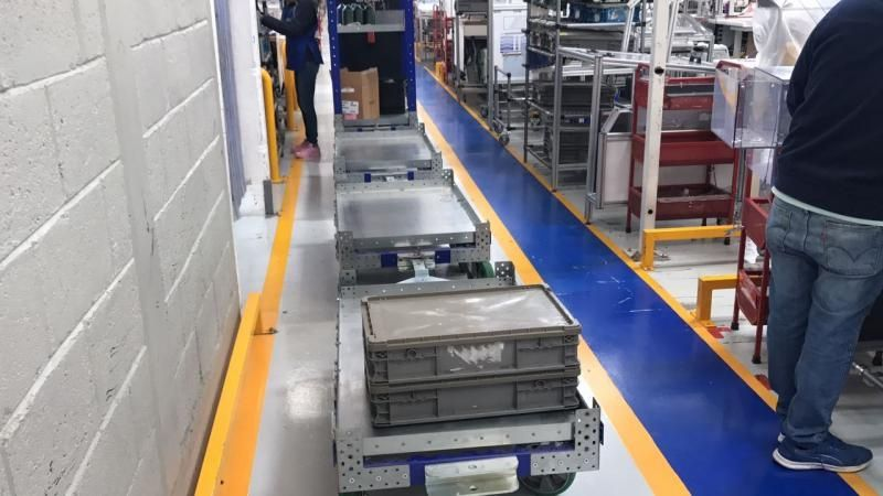 FlexQube tugger carts in a factory