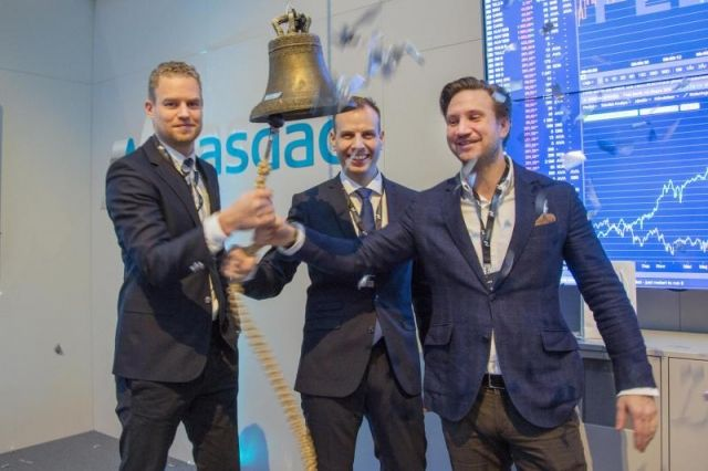 FlexQube founders ringing the NASDAQ bell