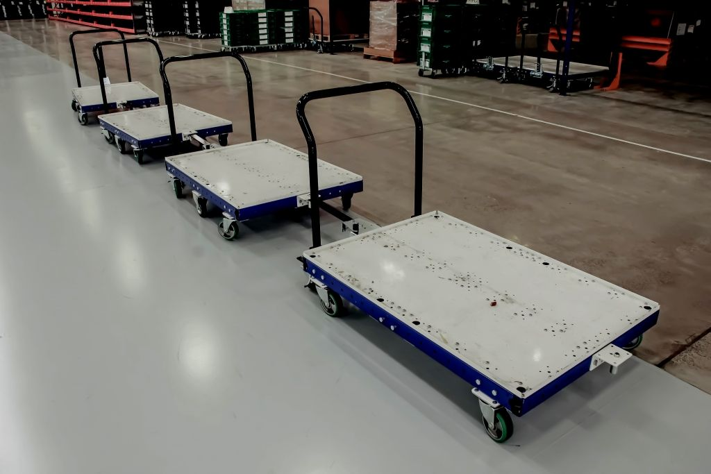 FlexQube pallet carts in a tugger train