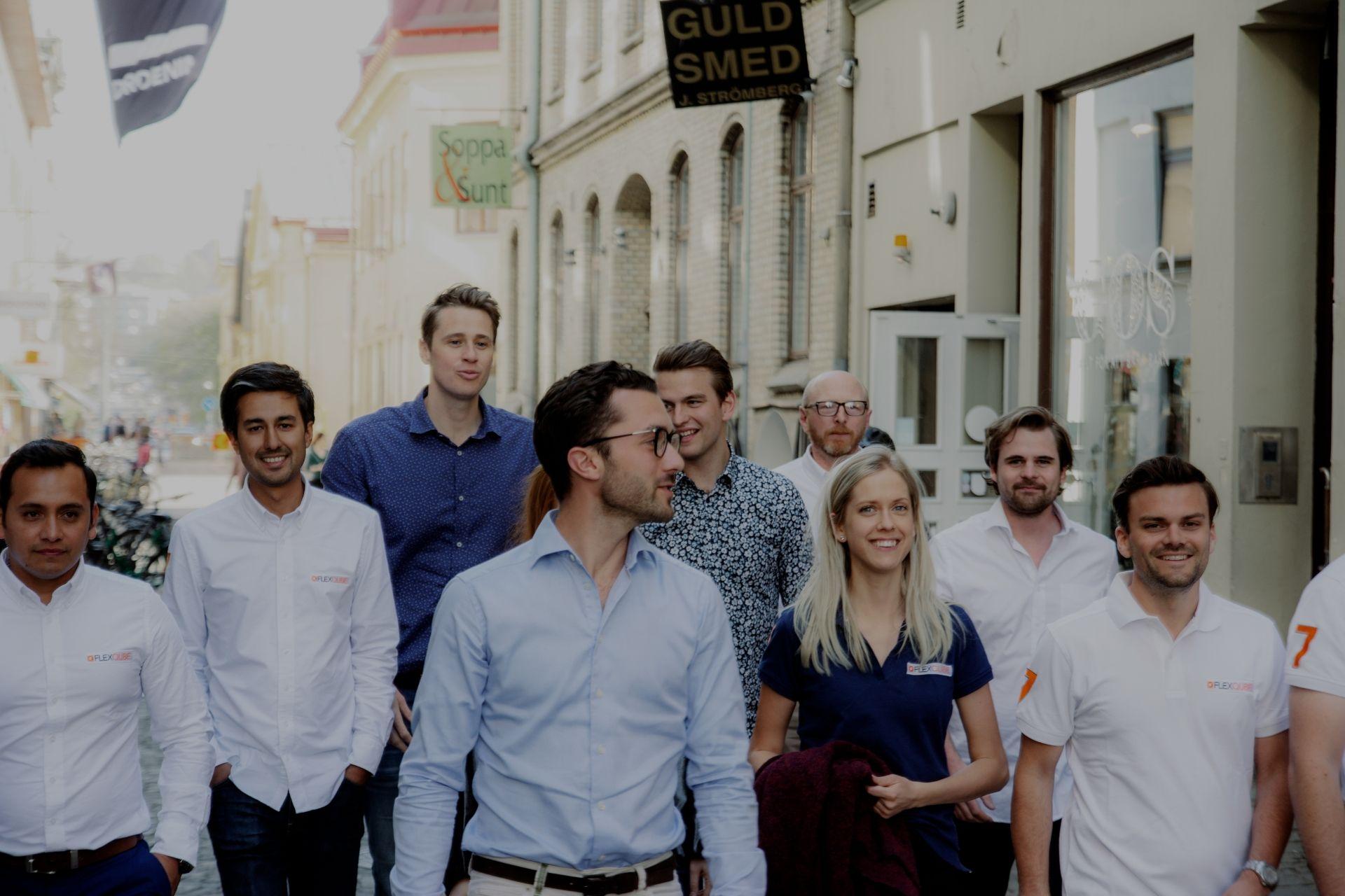 FlexQube team walking down the street.