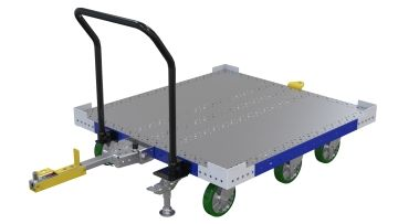 Tugger cart with steel deck designed for transporting containers and boxes.
