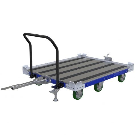 Tugger cart with polyurethane casters and flat steel deck with friction strips.