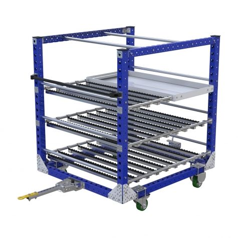 Tugger cart with three levels, with rollers and a shelf for transporting different parts in boxes or loose parts on the shelf.