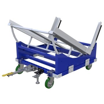 Tuggable tilt cart designed to store and transport pallets and containers between the warehouse and assembly area.