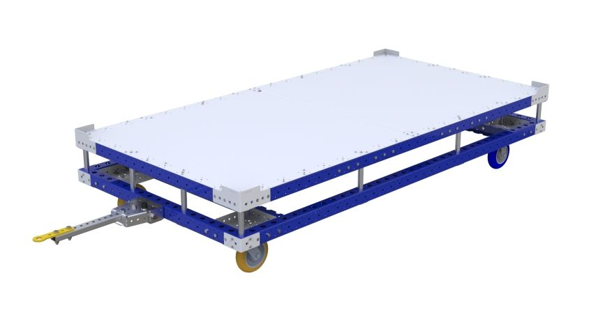 A larger pallet tugger cart to transport heavy containers and pallets.