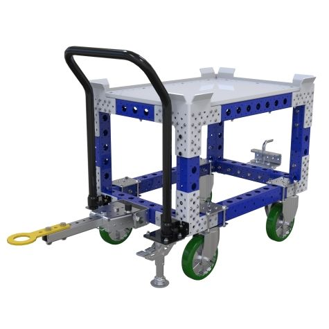 This tuggable pallet/container cart is elevated to have the loading area at an ergonomic height.
