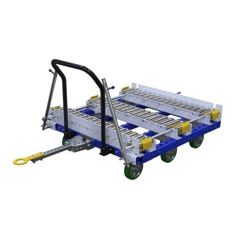 Tuggable conveyor cart for pallet transportation.