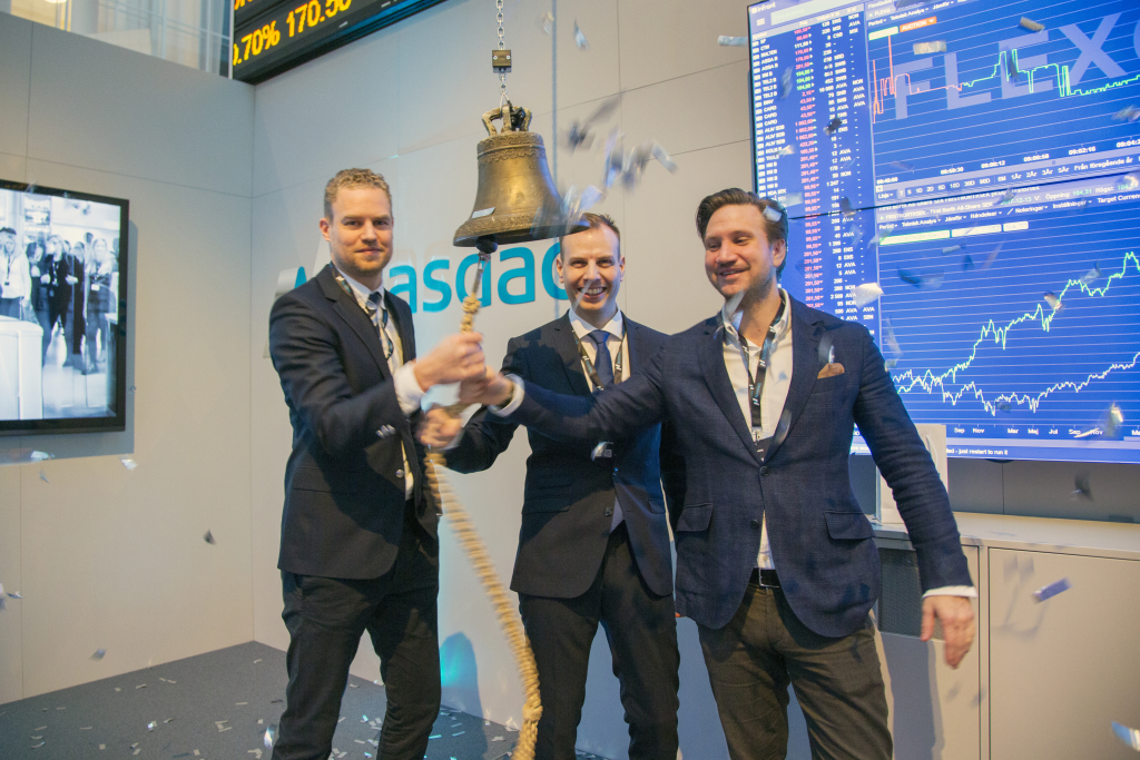 The FlexQube founders ringing the NASDAQ bell