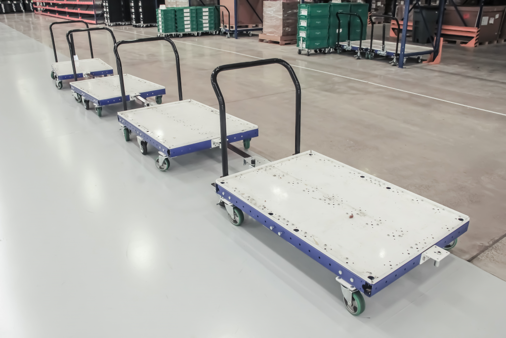 FlexQube tugger carts in a customer factory in Mexico