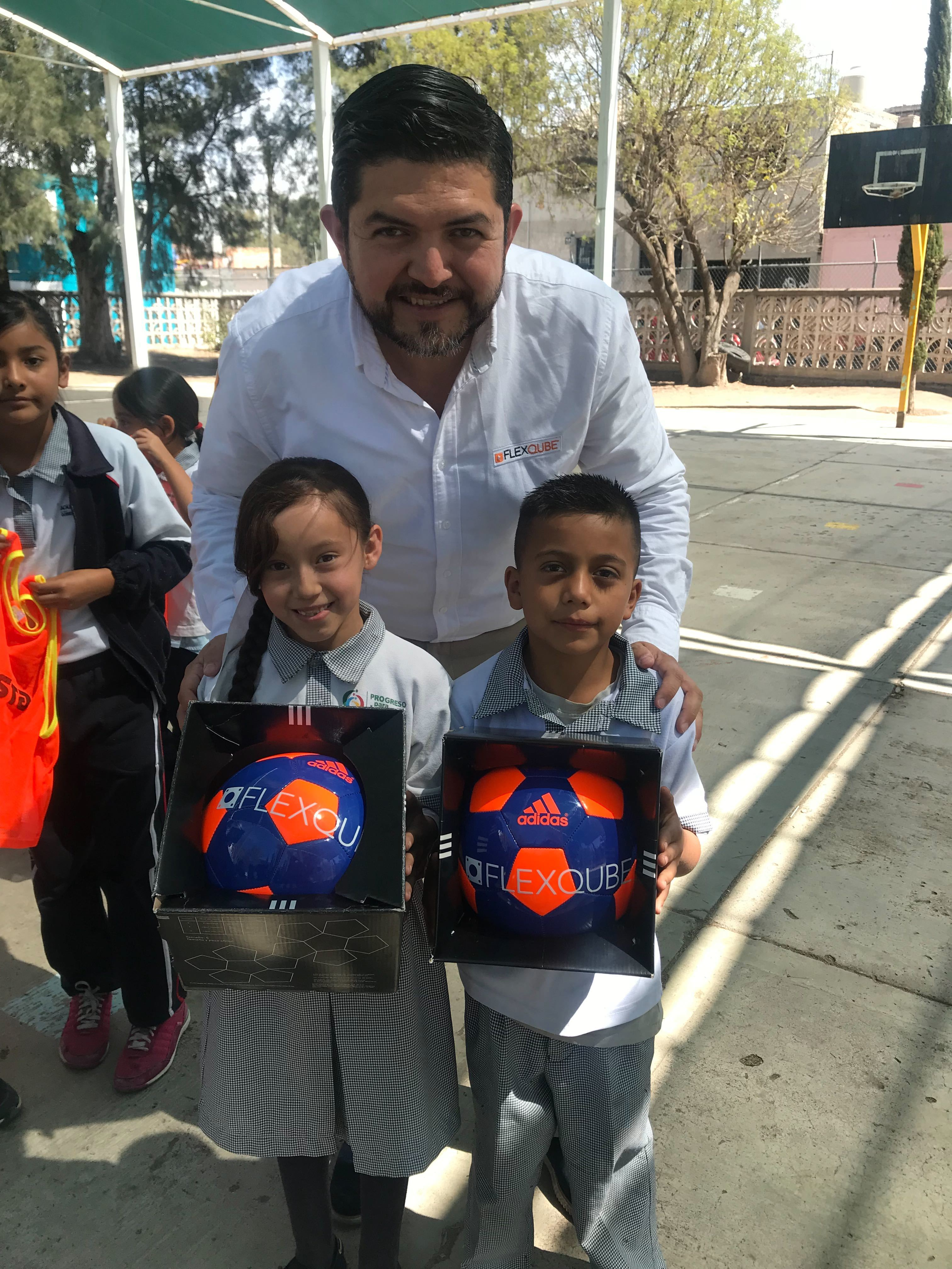 FlexQube Mexico Sales Manager Hector Flores giving our footballs to children in Mexico